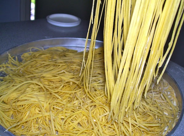 Roll dough by hand or through a pasta machine and cut to desired shape....
