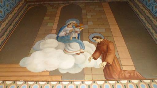 O quadro remete a aparição do menino Jesus a Santo Antônio e à glória que Deus o presenteou.