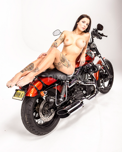 Nude lady on a harley