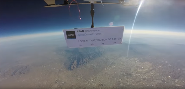 Screenshot fro a video of the 'First Protest in Space', taken from a weather balloon at 90,000 feet altitude. The protest was mounted by the Autonomous Space Agency Network, who were protesting Trump's proposed budget cuts to NASA Earth-observing missions. 'The group lamented White House budget cuts to four of NASA's Earth science missions: CLARREO, the solar wind monitoring system DSCOVR, the ocean and atmosphere monitoring program PACE, and the orbiting carbon observatory OCO-3. The message reads, 'Look at that, you son of a bitch', which is a famous quote by Apollo 14 astronaut Edgar Mitchell. Photo: Autonomous Space Agency Network