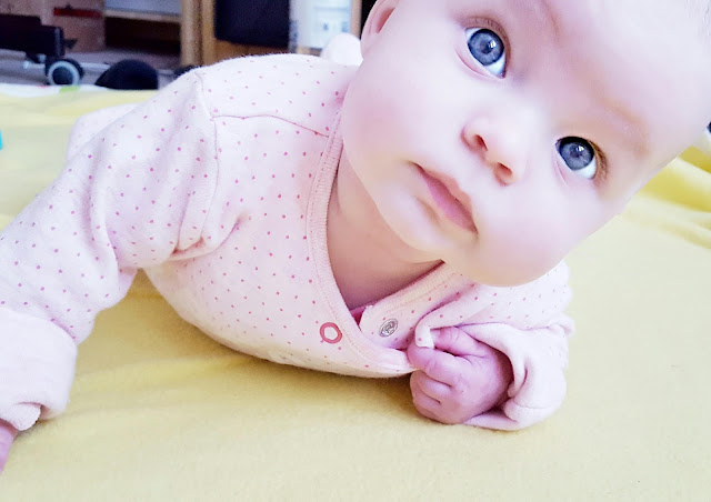 Baby girl tummy time