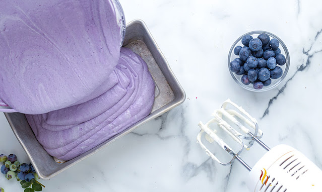 blueberry ice cream poured into a pan