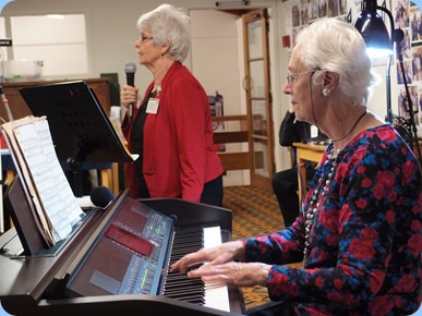 Julia Bissett singing for us with Dorothy Waddel accompanying on the Clavinova. Photo Courtesy of Dennis Lyons.