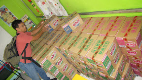 A man stacking boxes