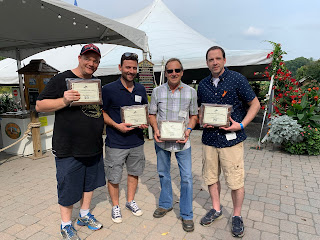 Corcoran Management Company employees posing with their 15 year plaques at Kimball Farm