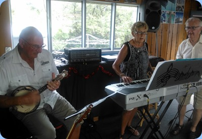 Our gracious hosts for the day, Jan and Kevin Johnston, giving a performance. Kevin playing his banjo/ukelele.