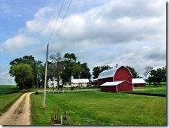 Long driveway and big barns