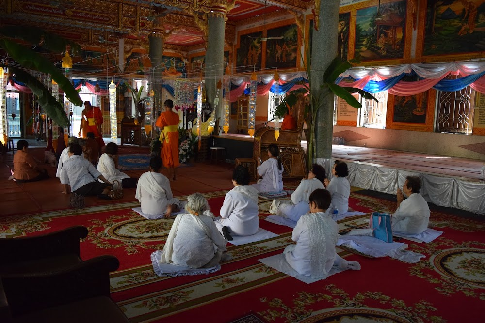 monks performing some kind of ceremony with a group of old ladies at Klang Temple...