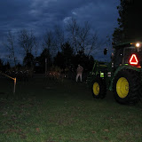 It was still dark enough to require the lights on the tractor.