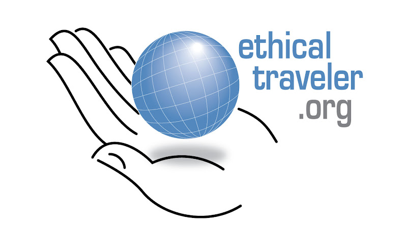 ethical traveler logo, graphic of a hand holding the earth