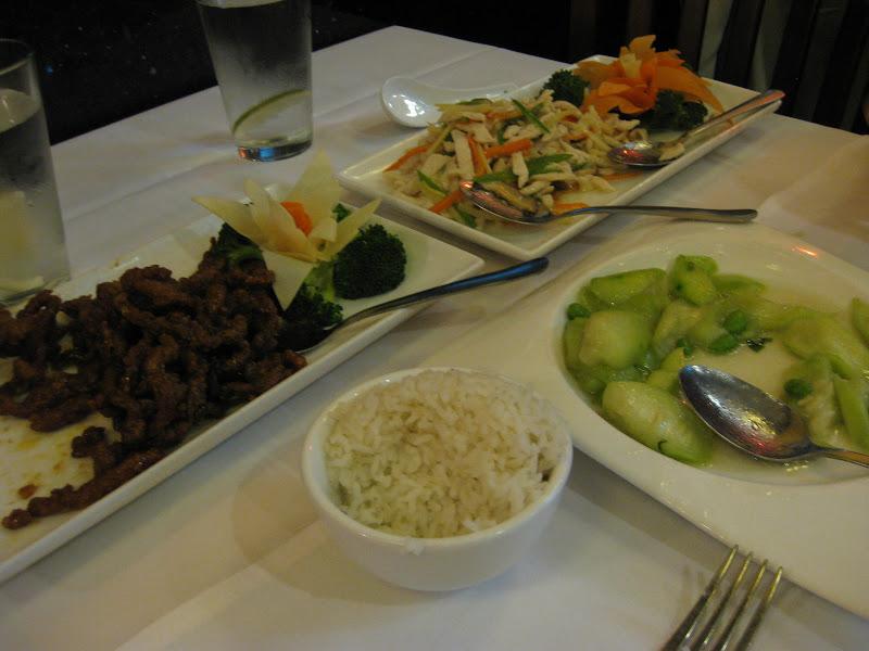 Clockwise from left, crispy shredded beef, rainbow chicken, luffa with soybeans and some white rice