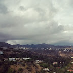 #HollywoodSign on the left, #GriffithObservatory to the right. Taken yesterday 4/25/15 at #RunyonCanyon after in rained, but you could see it #raining in the distance. #hike #hiking #Hollywood #LosAngeles #clouds #postrain