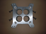Special 4 barrel adapter to put newer Carter AFB, AVS or Edelbrock (and Holleys) carburetors on the 1956 and earlier  intakes. 80.00 for cast aluminum and 40.00 for diecast.