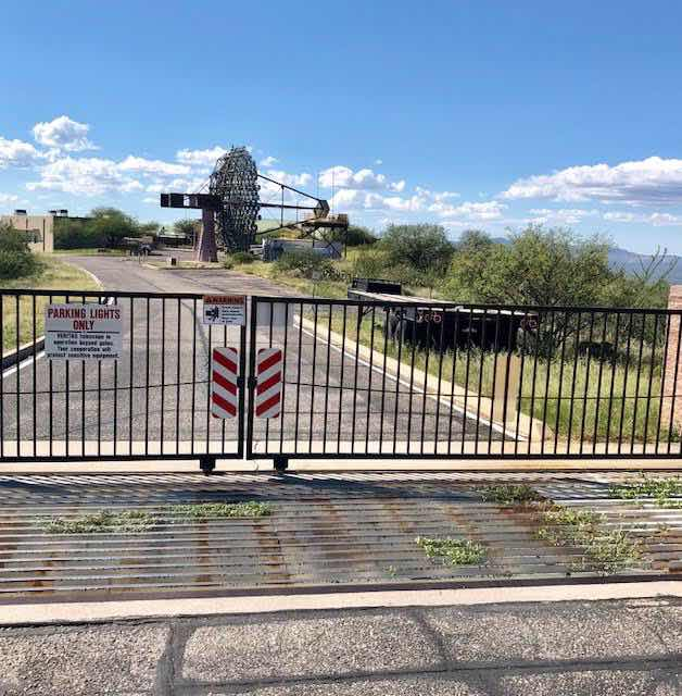 One VERITAS Cherenkov light telescopes is visible beyond closed gate at Mt. Whipple Observatory Visitor Center (Source: Palmia Observatory)
