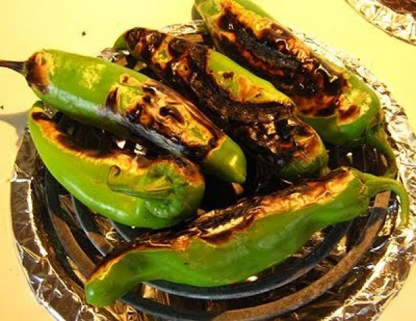 Wash your chiles; broil- or grill them until the skin blisters all around the...