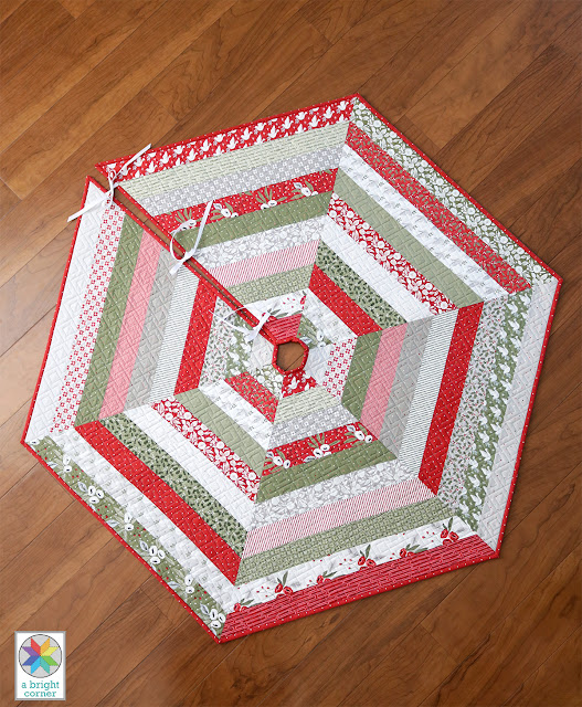 A Jelly Roll tree skirt pattern called Holly Jolly - pattern by Andy Knowlton of A Bright Corner - quilted Christmas tree skirt pattern