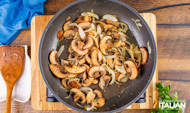 onions and mushrooms cooked in skillet