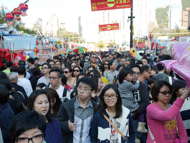 dense crowd at the Victoria Park Lunar New Year Fair in Hong Kong