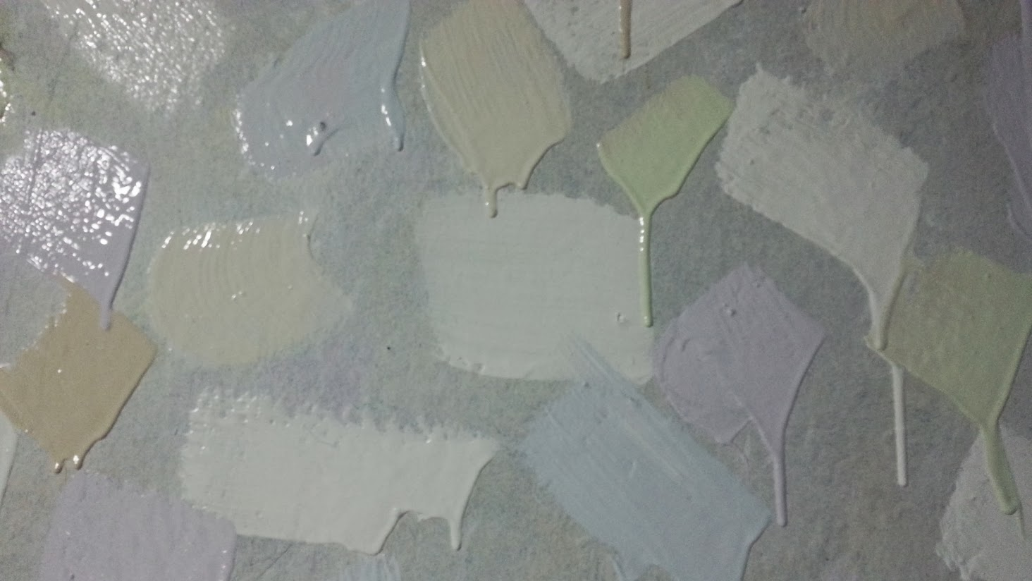 detail of multi-pastel brush strokes showing paint dripping down the wall