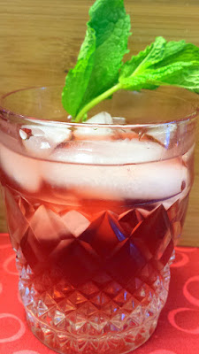 A take on a julep with 2 ounces of Pendleton Midnight whiskey, 1 ounce of Pomegranate juice, 1 ounce of simple syrup, Sprig of mint
