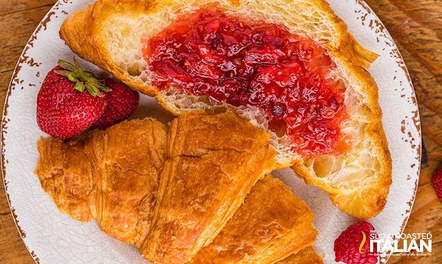 berry jam spread on a croissant