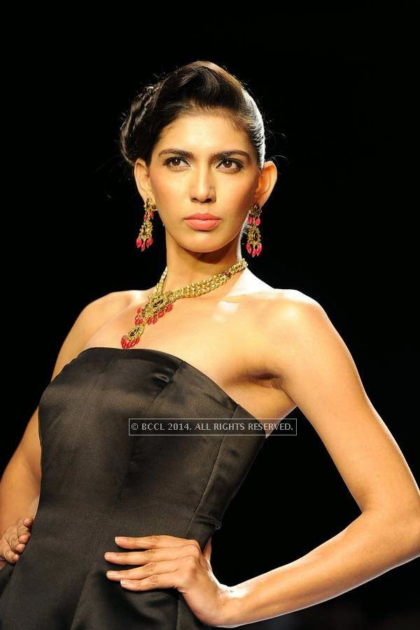 A model walks the ramp for AKS Jewels on Day 2 of India International Jewellery Week (IIJW), 2014, held at Grand Hyatt, in Mumbai.<br />