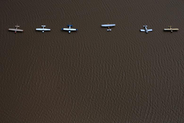 Planes are surrounded by Hurricane Harvey floodwaters at the West Houston Airport. Photo: Adrees Latif / REUTERS
