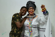 Sculptor Lungelo Dlamini alongside a wax creation of Winnie Madikizela-Mandela.