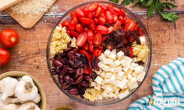 feta pasta salad ingredients sectioned in bowl