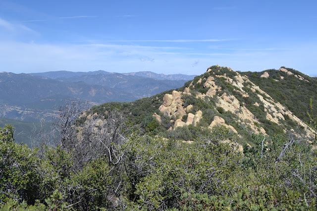 rocky ridge and distant peaks