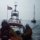 Poole ILB towing an 8m yacht in Poole Bay - 23/07/2013.  Photo credit: RNLI/Poole
