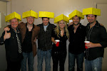 Sooo...we decided to pay $10 a pop for cheese-heads so we could wear them onstage.  Aden cut a mohawk-slot into his