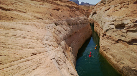 Kayak ride through a Face canyon in Lake Powell