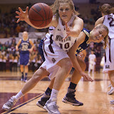 Kenzie DeBoer reaches for a loose ball as Northern Colorado's Lauren Oosdyke pushes them both to the ground.  Dahlberg Arena in Missoula, Mont., January 12th, 2013.