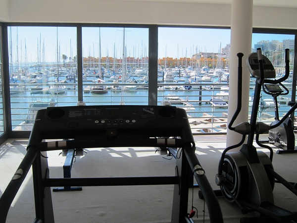 gym with the view to the marina in Tivoli Marina Portimao Resort