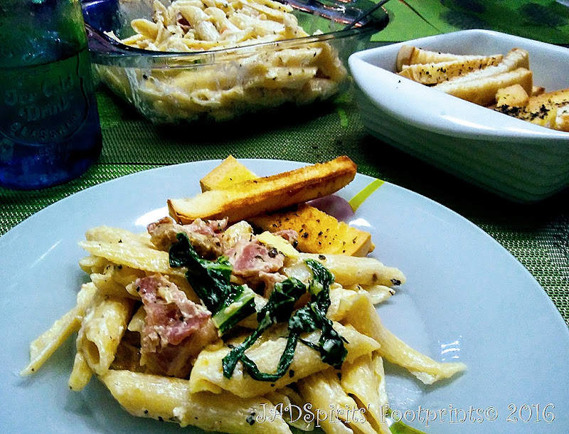 Creamy bacon chicken pasta with pechay served with basil bread