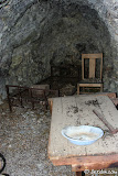 A crudely made table sits on one sit of the tunnel.