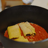Manicotti goes into dutch oven on a bed of sauce