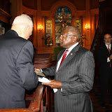 Congressman James Clyburn presents Senator Fritz Hollings a copy of the bill that changes the name of Charleston's Federal Judicial Complex to the J. Waties Waring Federal Building and United States Courthouse.
