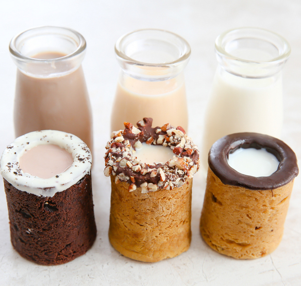 photo of three cookie shots with bottles of milk