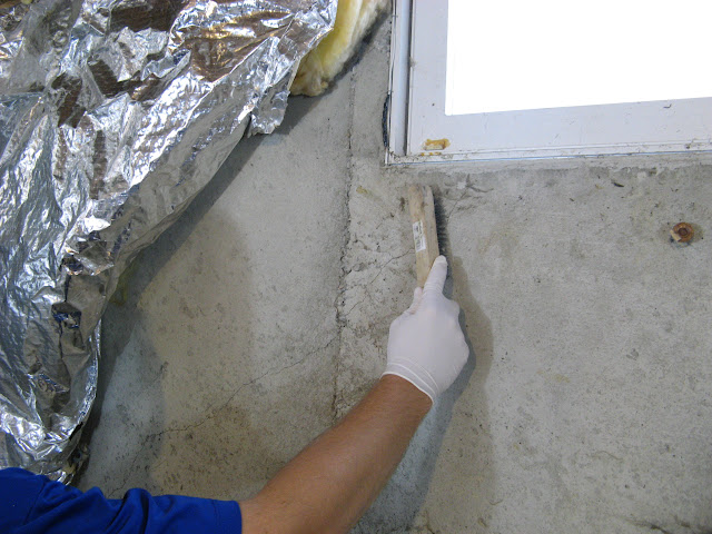 this foundation crack is under the basement window and leaks water