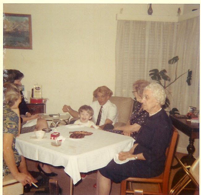 Dinner at 629 W. 36th St. in Long Beach.  Dorothy Caldwell, Virginia Boekman, Robert Boekman with little foster child Bobby, Henrietta Boekman and Aunt Meal