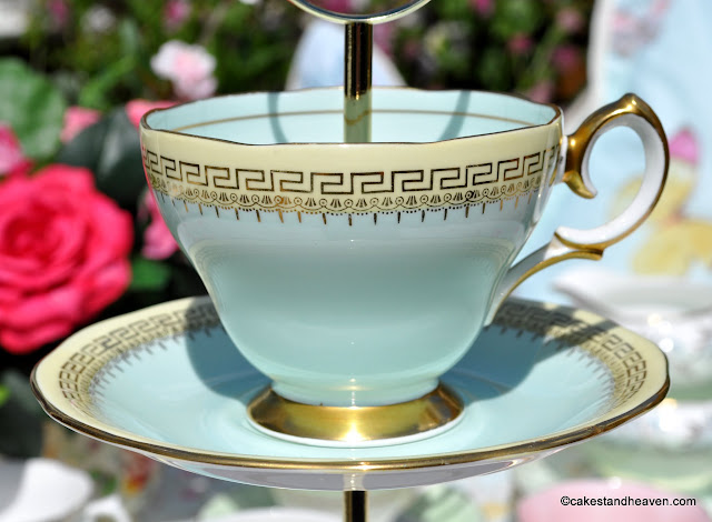 Queen Anne duck egg blue vintage teacup on a cake stand