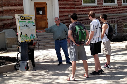 This is Jimmy, one of our volunteers. He has a genuine love for Jesus and a genuine love for people, and it comes through. In this photo he's walking three UNH students through the gospel message.