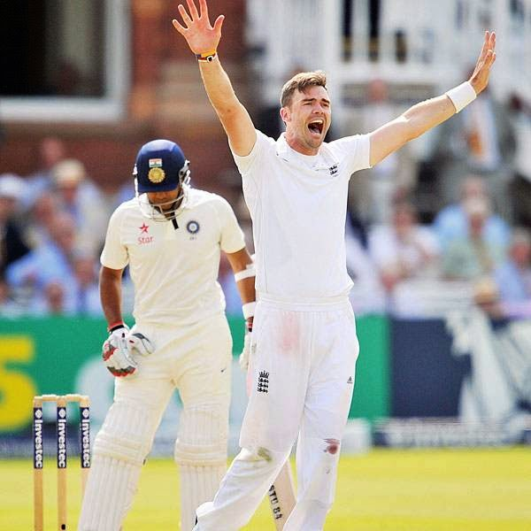 England's James Anderson (R) appeals successfully for the wicket of India's Stuart Binny for 9 runs during the first day of the second Test cricket match between England and India, at Lord's Cricket Ground in London, on July 17, 2014.