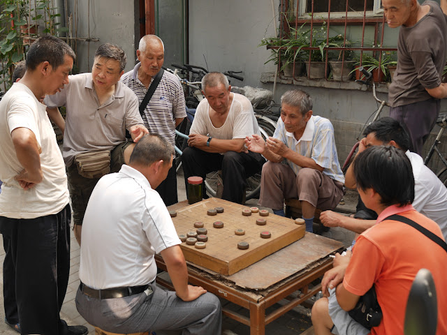 Men discussing a xiangqi game in Beijing