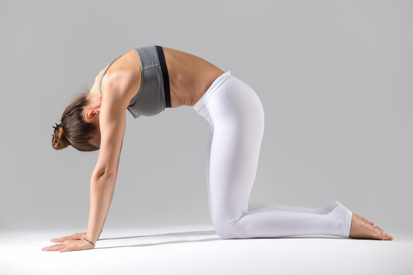 Cat Pose is like a gentle massage to the spine and belly organs