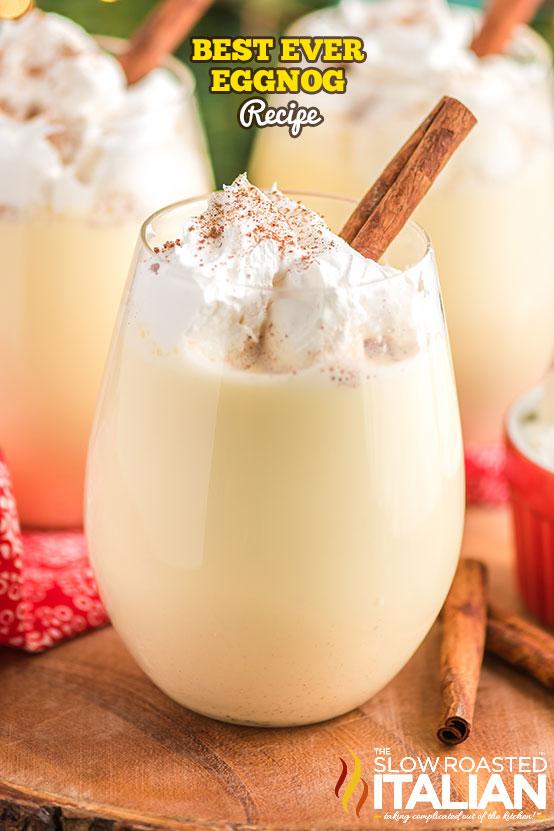 Best Ever Eggnog Recipe in a glass on a board