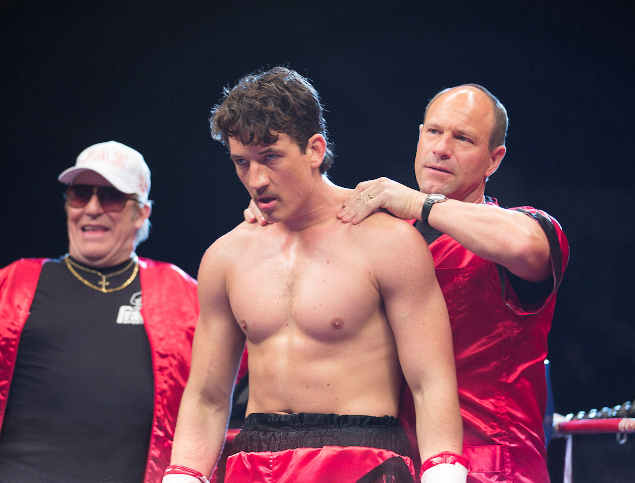 Miles Teller (center) stars as Vinny Pazienza and Aaron Eckhart (right) stars as Kevin Rooney in BLEED FOR THIS. (Photo by Seacia Pavao / Open Road Films).