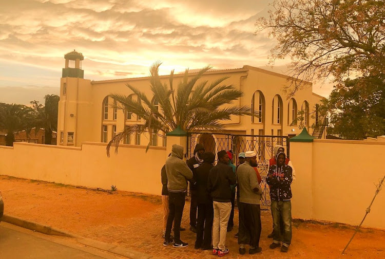 Muslims gather outside Malmesbury mosque, where three men were killed. Picture: ESA ALEXANDER